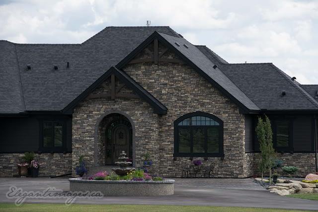 Black Hardie house with rock viklund contracting Carstairs