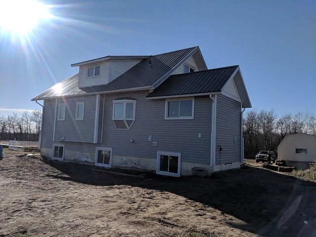 old-farm-house-gets-new-estate-grey-vinyl-siding